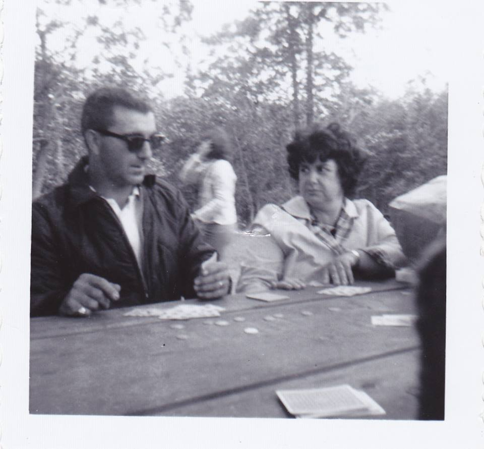 My parents during an intense card game at one of our family picnics, circa 1965